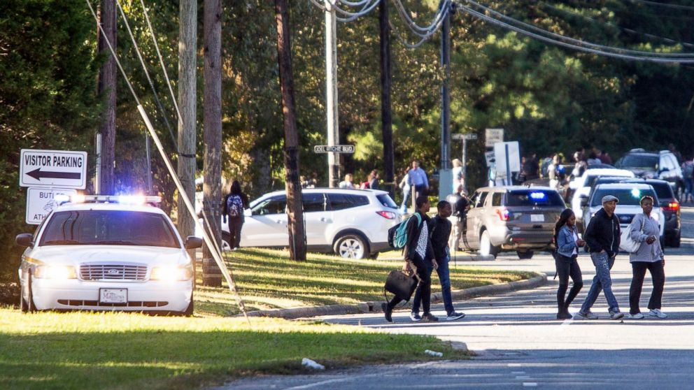 Parents walked to go pick up their kids outside Butler High School after the scene was considered safe in Matthews, N.C., Oct. 29, 2018.