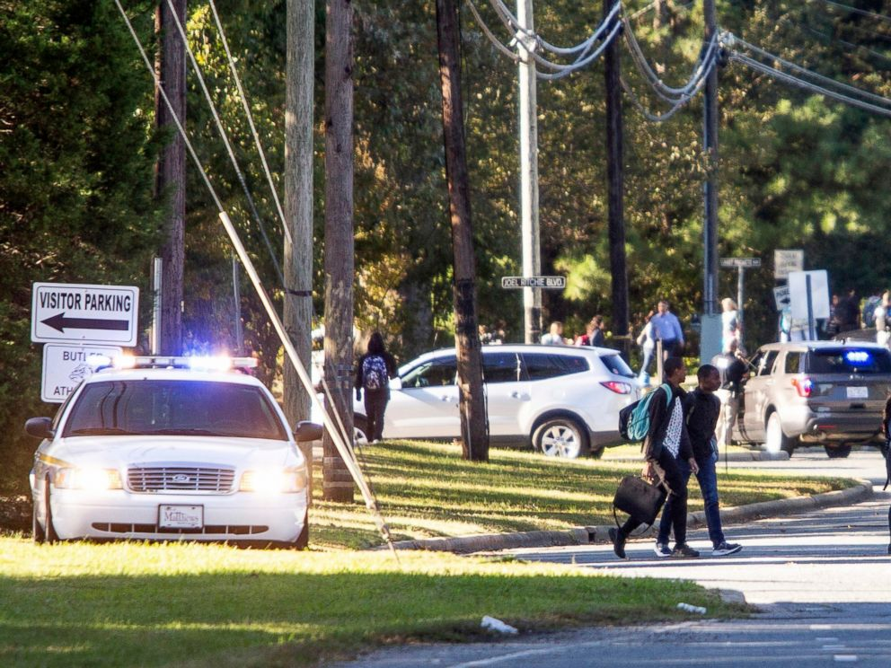 PHOTO: Parents walked to go pick up their kids outside Butler High School after the scene was considered safe in Matthews, N.C., Oct. 29, 2018.
