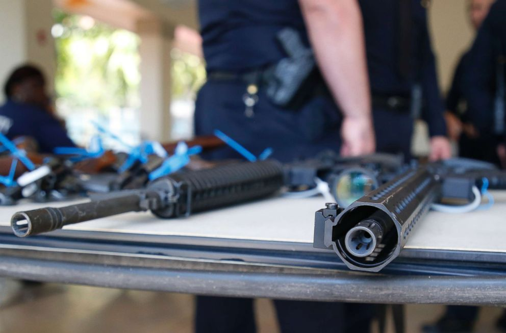 PHOTO: Two AR-15 rifles sit on a table after being surrendered during a City of Miami gun buy-back event in Miami, March 17, 2018.