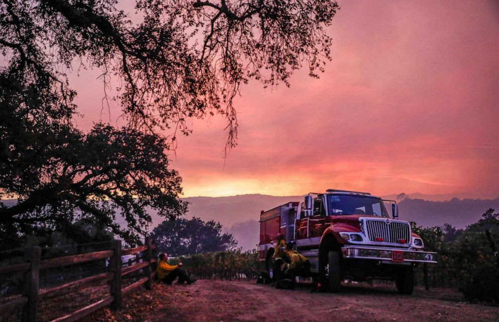 PHOTO: A fire engine waits at the top of a hill overseeing the Kincade Fire in the hills in Geyserville, California, on Thursday, Oct. 24, 2019.