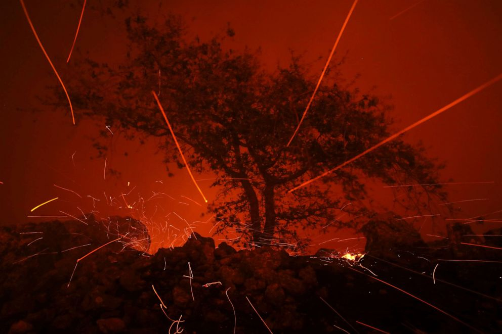 PHOTO: Embers blow in the wind as the Kincaide Fire burns through the area on October 24, 2019 in Geyserville, California.