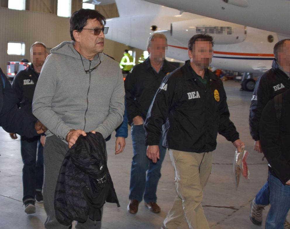 PHOTO: Federal agents escort David Cardona-Cardona as he arrives in the U.S. to face drug charges.