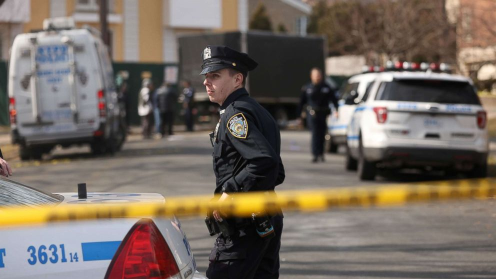 Police stand near where reputed mob boss Francesco Franky Boy Cali lived and was gunned down, March 14, 2019, in Staten Island, New York.