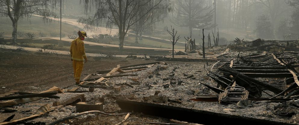 PHOTO: A firefighter searches for human remains in a trailer park destroyed in the Camp Fire, Friday, Nov. 16, 2018, in Paradise, Calif.