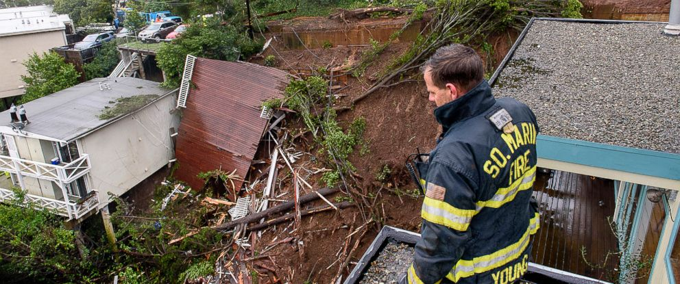 PHOTO: Firefighter/paramedic Patrick Young with the Southern Marin Fire Department looks out over the aftermath of a mudslide that destroyed three homes on a hillside in Sausalito, Calif., Thursday, Feb. 14, 2019.