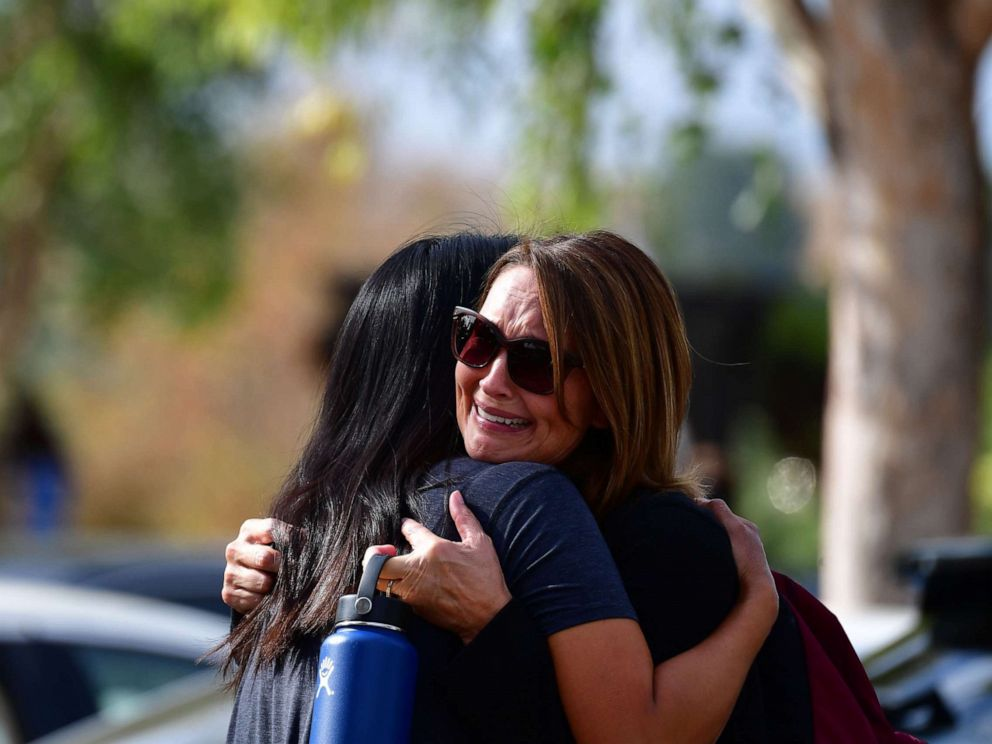 PHOTO: Women embrace in Central Park after a shooting at Saugus High School in Santa Clarita, California, Nov. 14, 2019.