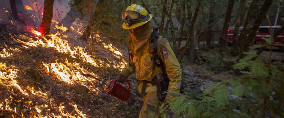 PHOTO: A firefighter uses a drip torch to set a backfire to protect houses in Adobe Canyon during the Nuns Fire, Oct. 15, 2017, near Santa Rosa, Calif.