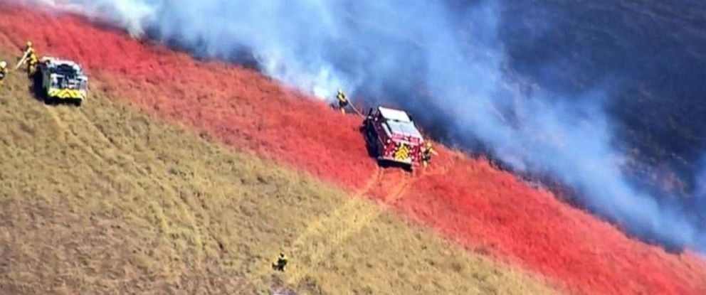 PHOTO: Firefighters battled a brush fire in Dublin, Calif., on Friday, Aug. 9, 2019, as it spread to over 50 acres.