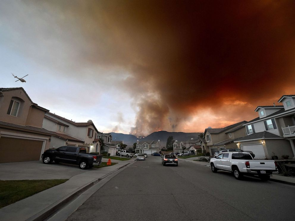 PHOTO: A fire burns in and above Cole Canyon behind homes on Sherry Lane in Murrieta, Calif., Sep 4, 2019.