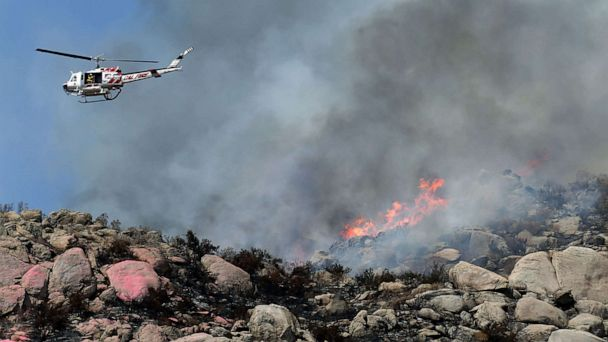 Wildfires continue spreading in California, Humberto veers away from the U.S.