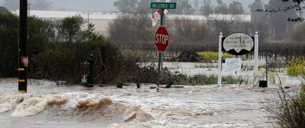 PHOTO: Water pours onto Millerick Road near the intersection of Highways 121 and 12 after the Sonoma Creek surged over its banks and flooded the roadways during the heavy rainstorm in Sonoma, Calif., Feb. 26, 2019.