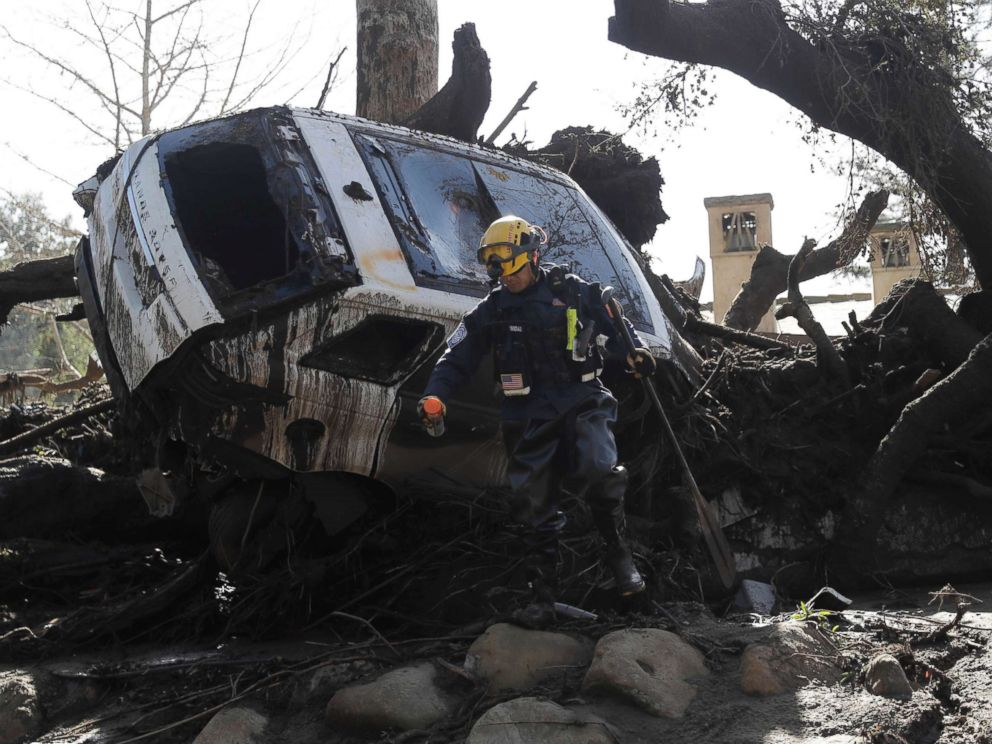 PHOTO: A member of the Los Angeles County Fire Department Search and Rescue crew works near a car trapped under debris in Montecito, Calif., Jan. 10, 2018.