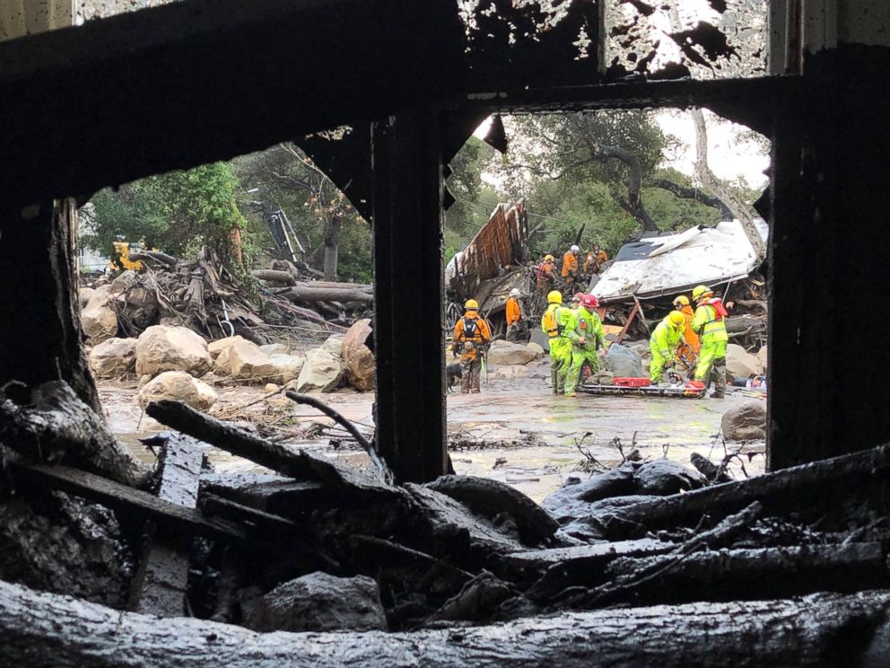 PHOTO: Firefighters search for trapped people in Montecito, Calif, Jan. 9, 2018, after mud and debris destroyed buildings following heavy rains.