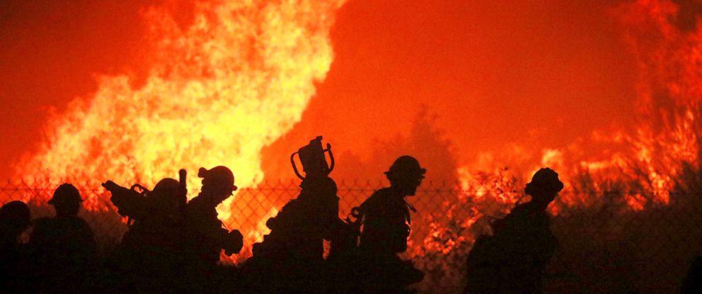 PHOTO: Firefighters battle the Saddleridge fire in Sylmar, Calif., Oct. 11, 2019.