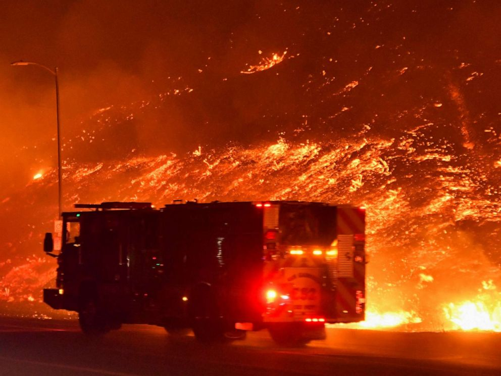 PHOTO: Firefighters battle a wind-driven wildfire in Sylmar, Calif., Oct. 11, 2019.
