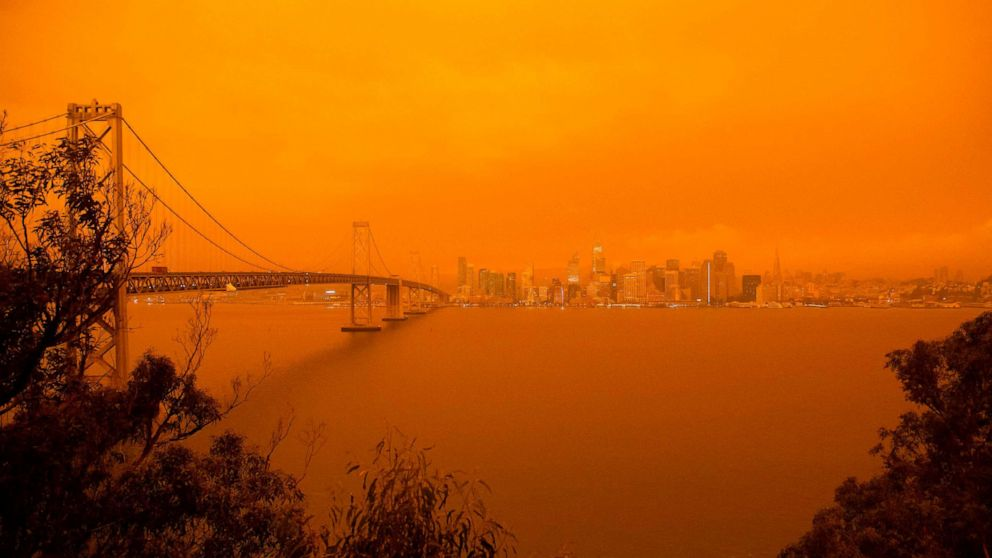 PHOTO: The San Francisco Bay Bridge and city skyline are obscured in orange smoke and haze as their seen from Treasure Island in San Francisco, Calif. on Sept. 9, 2020.