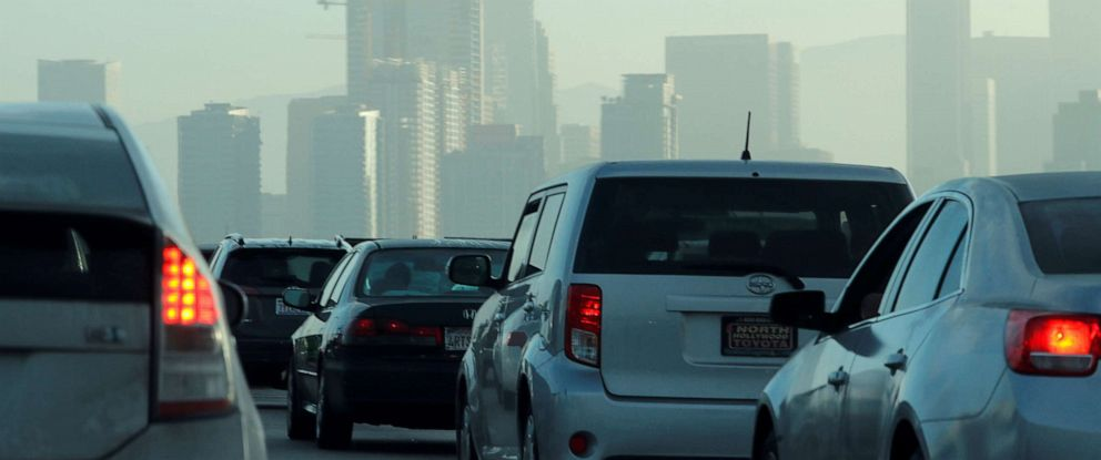 PHOTO: Commuters navigate early morning traffic as they drive towards downtown Los Angeles, July 22, 2019.