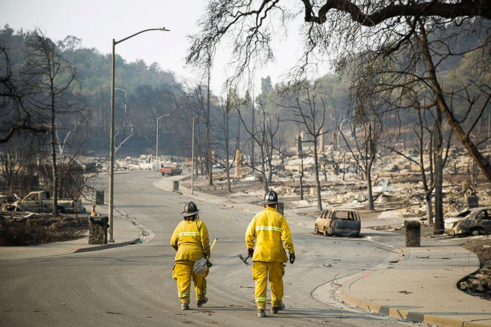 Firefighters walk through the Fountaingrove neighborhood, Oct. 13, 2017, in Santa Rosa, Calif.