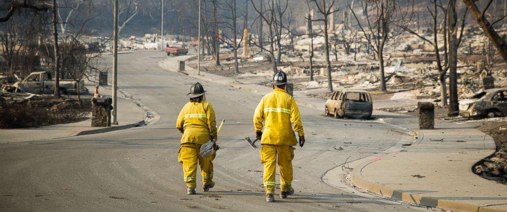 PHOTO: Firefighters walk through the Fountaingrove neighborhood on Oct. 13, 2017 in Santa Rosa, Calif.