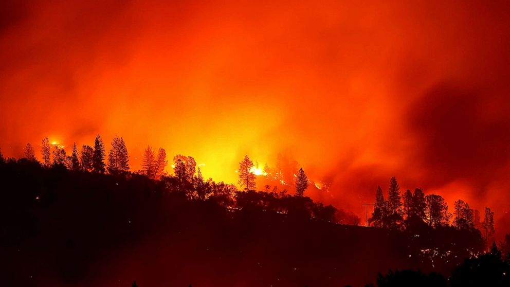 The Camp Fire burns in the hills, Nov. 11, 2018 near Oroville, Calif.