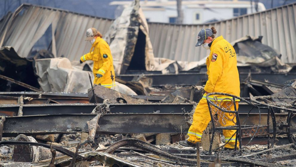 Firefighters search Ridgewood Mobile Home Park in the aftermath of the Camp Fire in Paradise, Calif., Nov. 12, 2018.