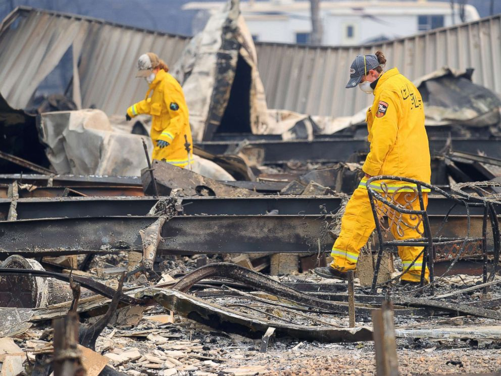 PHOTO: Firefighters search Ridgewood Mobile Home Park in the aftermath of the Camp Fire in Paradise, Calif., Nov. 12, 2018.
