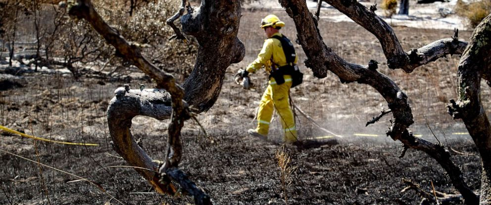 PHOTO: California fire crews put out a hot spot in the Santa Rosa Plateau Ecological Reserve area where the Tenaja fire burned in Murrieta on Sept. 9, 2019.