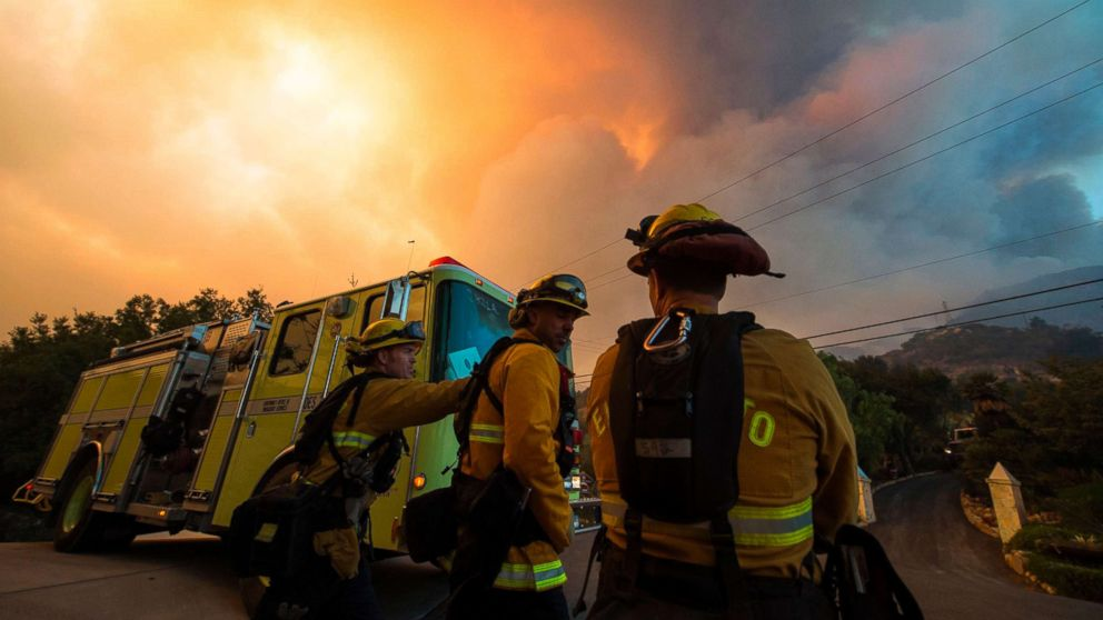 Firefighters from the Governors Office of Emergency Services monitor the advance of smoke and flames from the Thomas Fire, Dec. 16, 2017 in Montecito, Calif.
