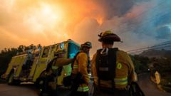 'PHOTO: Firefighters from the Governors Office of Emergency Services monitor the advance of smoke and flames from the Thomas Fire, Dec. 16, 2017 in Montecito, Calif.' from the web at 'https://s.abcnews.com/images/US/california-fires-4-gty-jt-171217_16x9t_240.jpg'