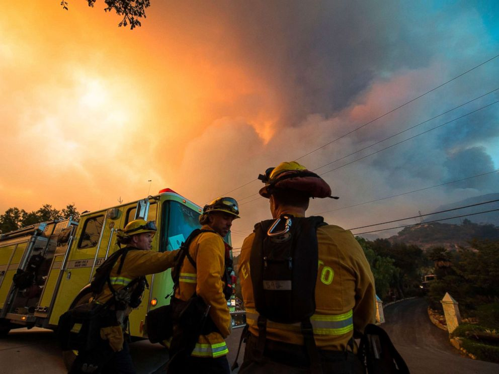 PHOTO: Firefighters from the Governors Office of Emergency Services monitor the advance of smoke and flames from the Thomas Fire, Dec. 16, 2017 in Montecito, Calif.