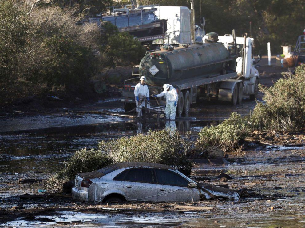PHOTO: Crews pump mud on Highway 101 after a mudslide, Jan. 13, 2018, in Montecito, Calif.