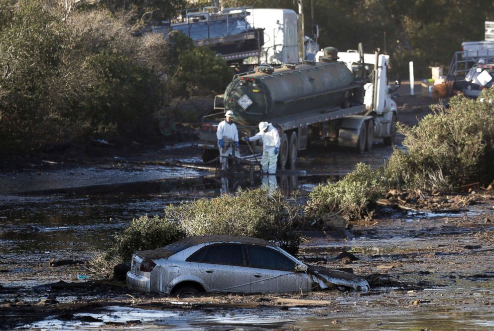 PHOTO: Crews pump mud on Highway 101 after a mudslide, Jan. 13, 2018, in Montecito, Calif.