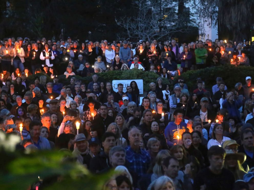PHOTO: People attend a candlelight vigil in Santa Barbara, Calif., Jan. 14, 2018, to pay tribute to the people who were killed when mudslides ravaged a Southern California.