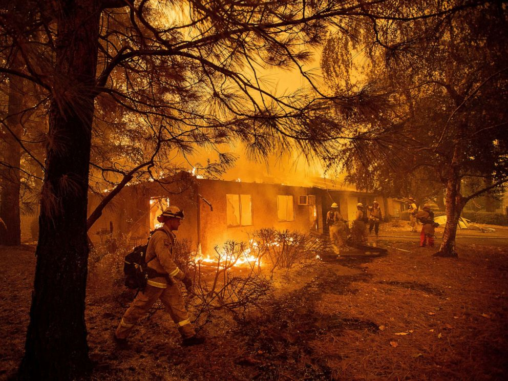 PHOTO: Firefighters work to keep flames from spreading through the Shadowbrook apartment complex as a wildfire burns through Paradise, Calif., Nov. 9, 2018.