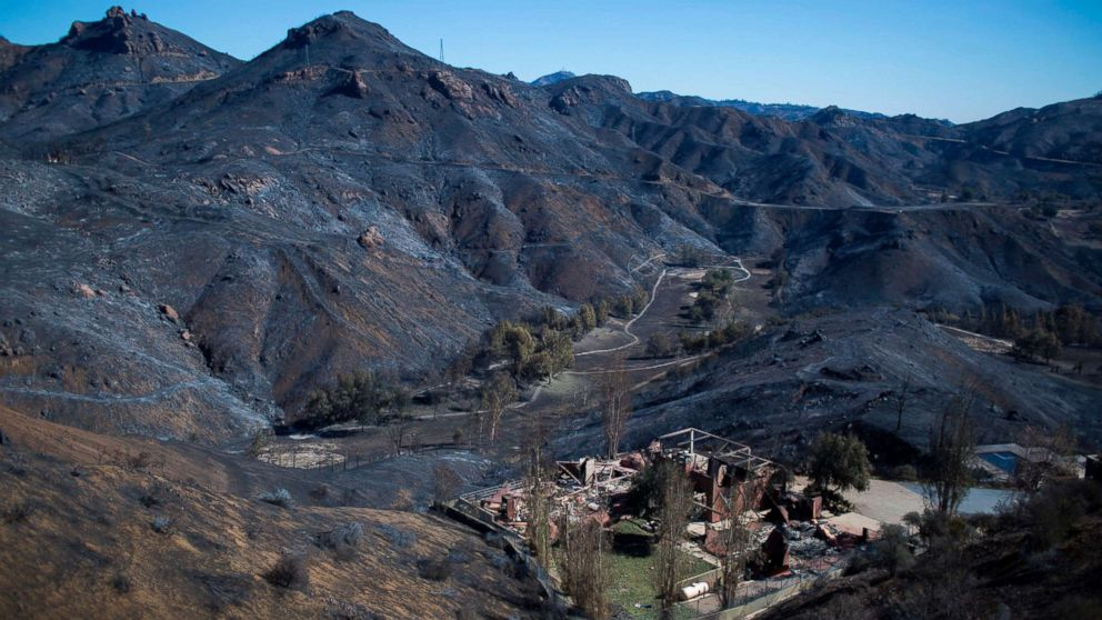 The Santa Monica Mountains are seen left blackened by the Woolsey Fire near Malibu, Calif., Nov. 14, 2018.