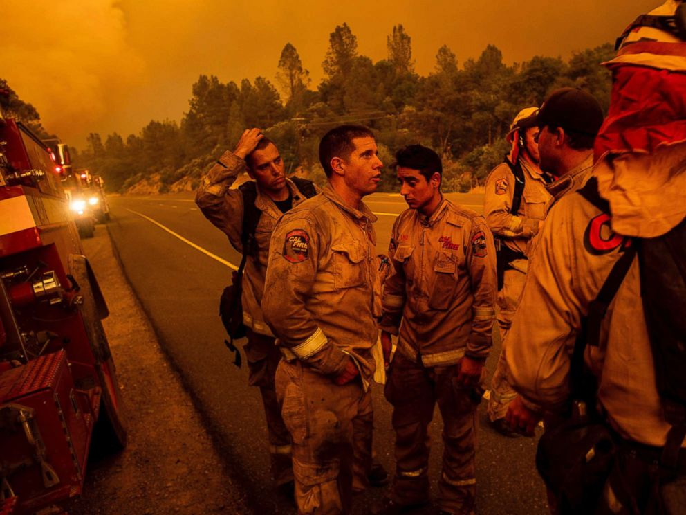 PHOTO: Firefighters discuss plans while battling the Carr Fire in Shasta, Calif., on Thursday, July 26, 2018.