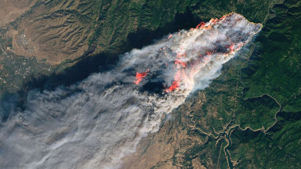This enhanced satellite image provided by NASA's Earth Observatory, shows a wildfire in Paradise, Calif., on Thursday, Nov. 8, 2018. Flames in the image were enhanced with infrared data.