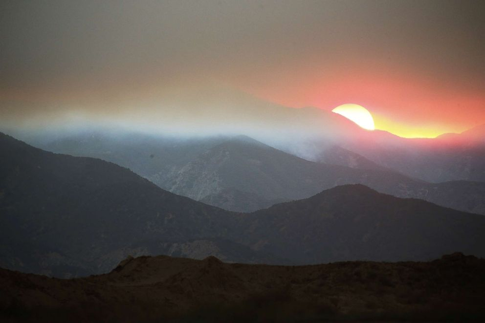 PHOTO: The sun sets behind smoke from the Holy Fire in Cleveland National Forest, Aug. 8, 2018 in Corona, Calif.