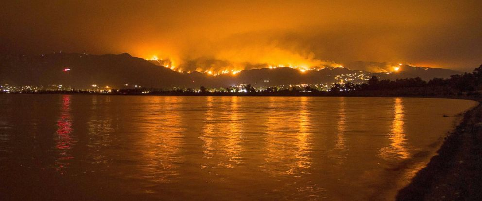 PHOTO: Flames from the Holy Fire are reflected in Lake Elsinore as the wildfire burns in the Cleveland National Forest, in Lake Elsinore, Calif., Aug. 8, 2018.