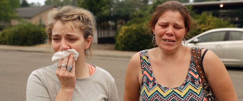 PHOTO: Sherry Bledsoe, left, cries next to her sister, Carla, outside of the sheriffs office after hearing news that Sherrys children, James and Emily, and grandmother, Melody Bledsoe, were killed in a wildfire, July 28, 2018, in Redding, Calif.