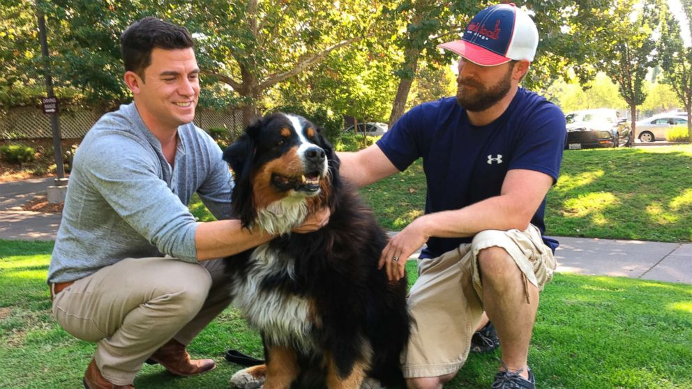 Jack Weaver, left, and his brother in law, Patrick Widen, pose with Izzy, a 9-year-old Bernese Mountain Dog, who belongs to Weaver's parents, Oct. 14, 2017, in Windsor, Calif.