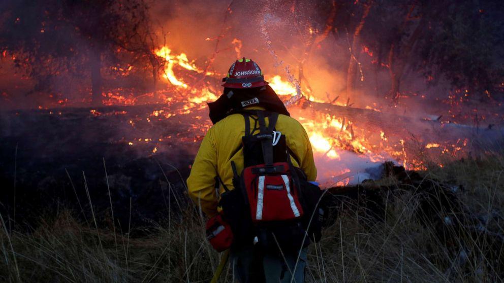 Firefighters battle a wildfire near Santa Rosa, Calif., Oct. 14, 2017.