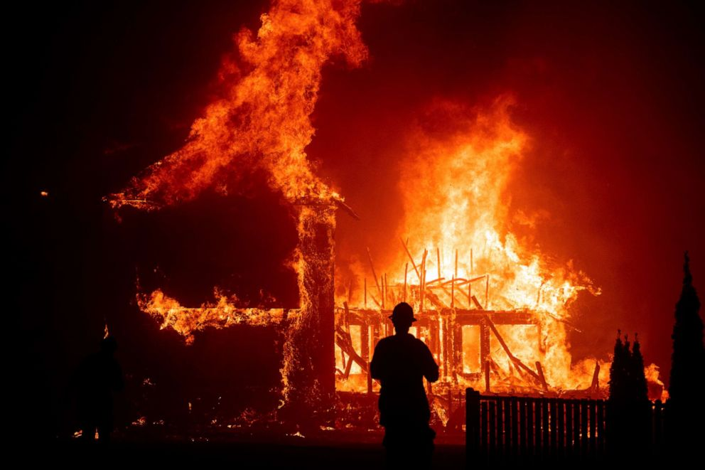 PHOTO: In this file photo taken on Nov. 8, 2018, a home burns during a wildfire in Paradise, California.