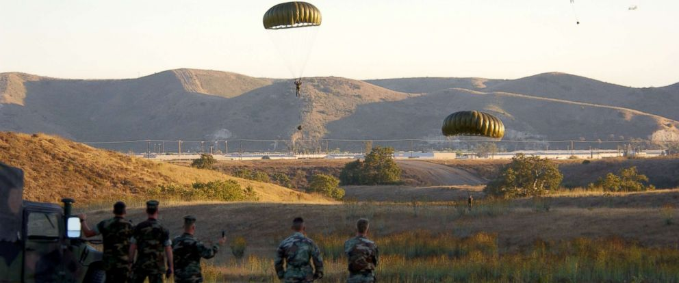 PHOTO: Soldiers parachute from a helicopter during combat readiness training, Sept. 25, 2001 at Camp Pendleton, Calif.
