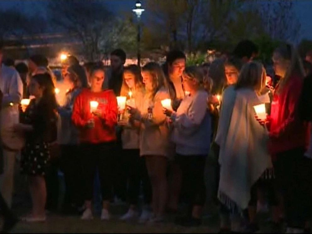 PHOTO: People gather for a candlelight vigil at the University of South Carolina for student Samantha Josephson, whose body was found on March 30, 2019.