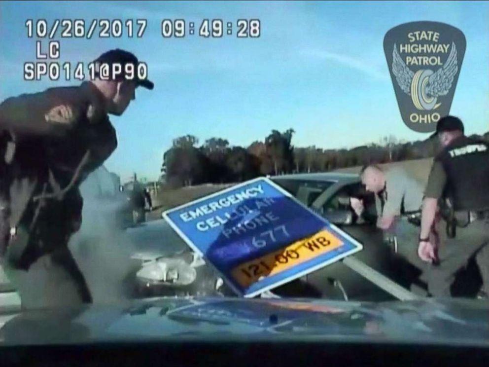 PHOTO: Officers confront a 10-year-old boy after he led them on a car chase, Oct. 26, 2017 on Interstate 90 near Cleveland, Ohio.