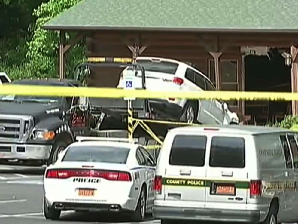 PHOTO: This frame grab from video shows an SUV being towed from the scene where authorities say Roger Self rammed his vehicle into a busy restaurant, Sunday, May 20, 2018, killing his daughter and another person in Bessemer City, N.C.