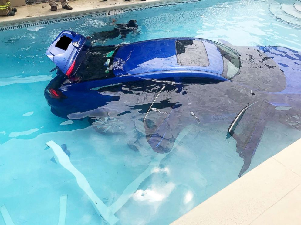 Auto rolls into pool with dad, daughter inside