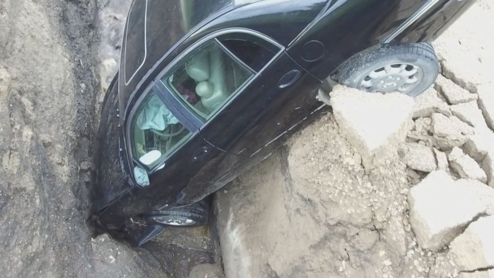 Teen escapes injury after driving into washed out road
