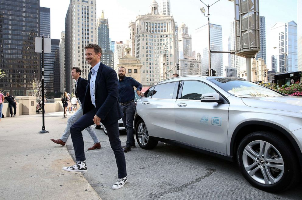 PHOTO: Mike Mikos, CFO car2go N.A., Olivier Reppert, Global CEO of car2go Group GmbH, and Paul DeLong, CEO of car2go N.A. arrive at the car2go launch event, July 25, 2018, in Chicago.